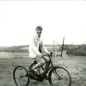 Dick Van Dyke rides a trike.