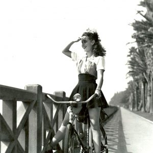 Susan Peters rides a bike.