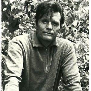 Jack Lord rides a bike.