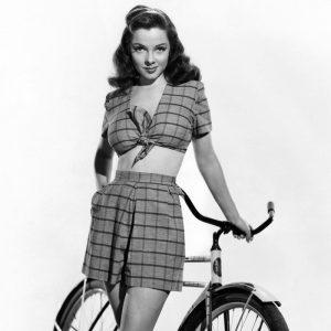 Kathryn Grayson models a bike.
