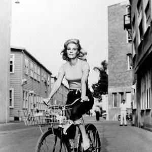 Yvette Mimieux rides a bike.