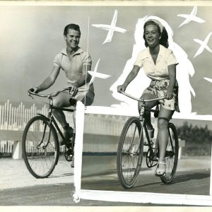 Jackie Cooper and Bonita Granville ride bikes. Chinagraph X's in hot pursuit.