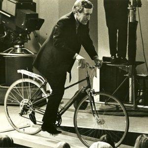 David Frost rides a bike.