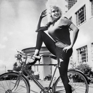 Jayne Mansfield rides a bike. In a manner of speaking.