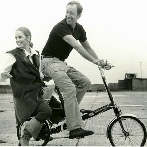 Liv Ullman and Anthony Harvey ride a bike.