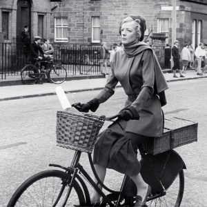 Maggie Smith rides a bike.