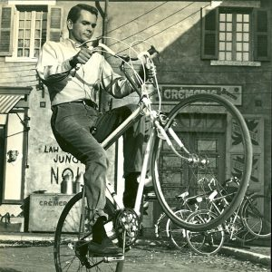 Dean Jones wheelies a bike.