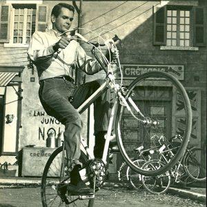 Dean Jones wheelies a bike.