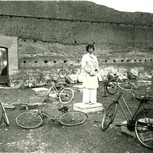 Elsa Martinelli surrounded by bikes.