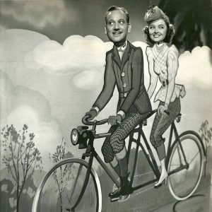 Melvyn Douglas and Myrna Loy ride a bike. In their heads.