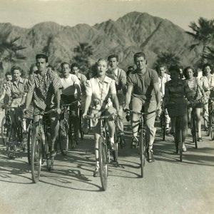 Bonita Granville rides a bike, with her singing peloton.