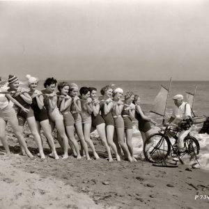 W.C. Fields rides a bike… out of the sea, with the help of a dozen bathing beauties. Happy holidays!
