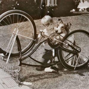 Jon Provost and Lassie fix a bike.