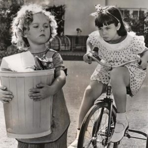 Shirley Temple doesn't ride a trike, Jane Withers does.