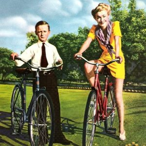 Constance Bennett and Peter Plant ride bikes.