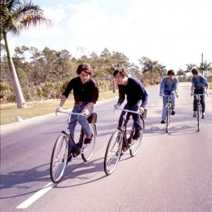 George, John, Paul and Ringo ride bikes.