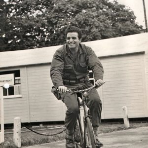 Vince Edwards rides a bike.