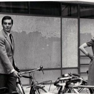 Alain Delon and Leslie Caron park bikes.