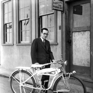 Harold Lloyd models a bike.