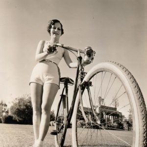 Muriel Evans wheels a bike.
