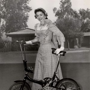 Jan Chaney walks a bike – a Katakura Silk folding bike.