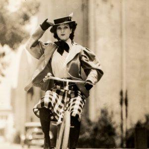 Jean Parker rides a bike.