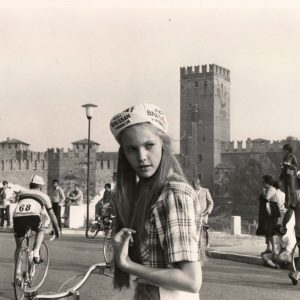 Diane Lane wears a casquette, walks a bike.