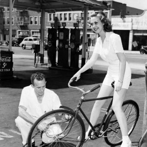 "Adele Mara rides a bike, gets some air. Adele Mara, Columbia actress, is not only dressed for a day in the California air (and sun) but she's getting a bit of free air in her bicycle tires before taking a bicycle holiday after finishing work with Fred Astaire and Rita Hayworth in ""You Were Never Lovelier."""
