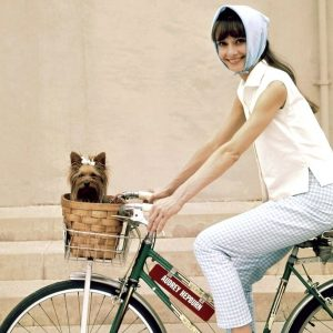 Audrey Hepburn and Assam ride a bike – Audrey's 85th birthday today.