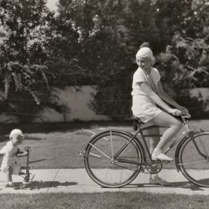 Helen Twelvetrees rides a bike, her son Jack Woody, Jr. toddle-carts behind. Happy Mother's Day from ridesabike.com!