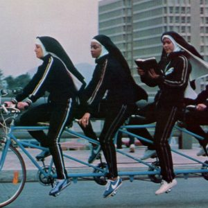 Americathon nuns ride a bike (and read a book). It's Bike to Work Day!