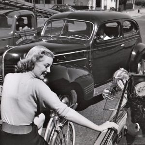 """Jan Sterling rides a bike, stops to chat. """"It's Bike to Work Day, not Drive to Work Day, bub!"""""""