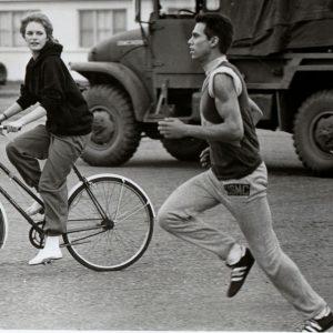 Claudia Cron rides a bike, Robby Benson runs.