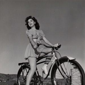 Ann Rutherford rides a bike.