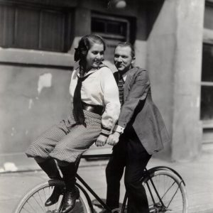 Lee Tracy and Evalyn Knapp ride a bike.