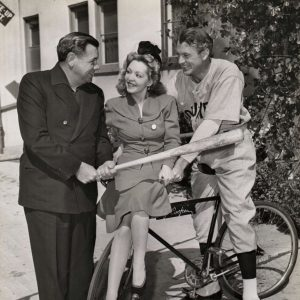 Gary Cooper and Margarita ride a bike. Babe Ruth rides a bat.