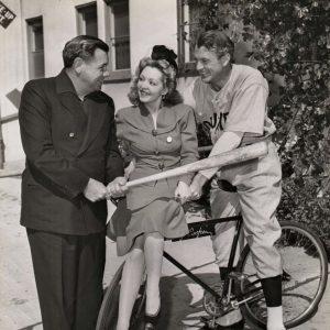 Gary Cooper and Margarita ride a bike. Babe Ruth rides a bat.