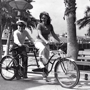 Charlie Chaplin and Paulette Goddard ride a tandem. Catalina Island, 1940.