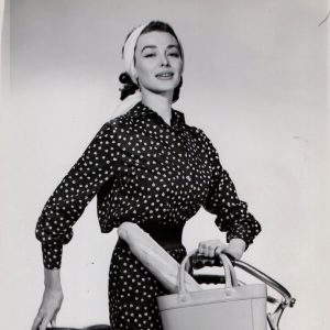 Dorian Leigh, the real-life Holly Golightly, models a bike.
