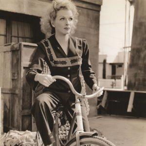 Doris Dudley rides a bike.