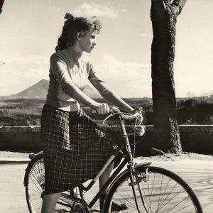 Carla Gravina rides a bike.