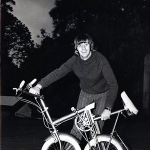 Ringo Starr folds a bike in his driveway, Weybridge, 1966.
