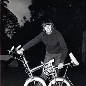 Ringo Starr folds a bike in his driveway, Weybridge, 1966.