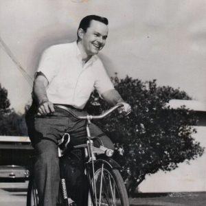 Bob Crane rides a bike.