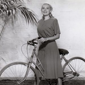 Barbara Bates rides a bike.