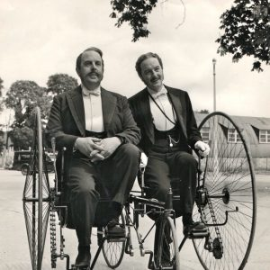 Robert Morley and Maurice Evans ride a bike.