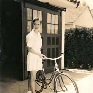 "Mae Clarke gets ready to ride. ""Mae Clarke, charming Metro-Goldwyn-Mayer featured player, joins the ranks of bicycling stars , who have recently taken up this popular Hollywood sport."""