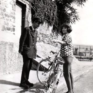 Gina Lollobrigida rides a bike, asks for directions.