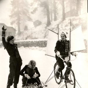 Gail Patrick rides a sailing ski bike, Verna Hillie rides a sled, Lona Andre ready-set-go's. Happy Winter Solstice from Rides a Bike!