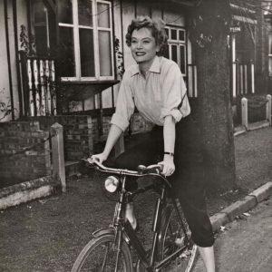 Alexis Smith rides a bike.
